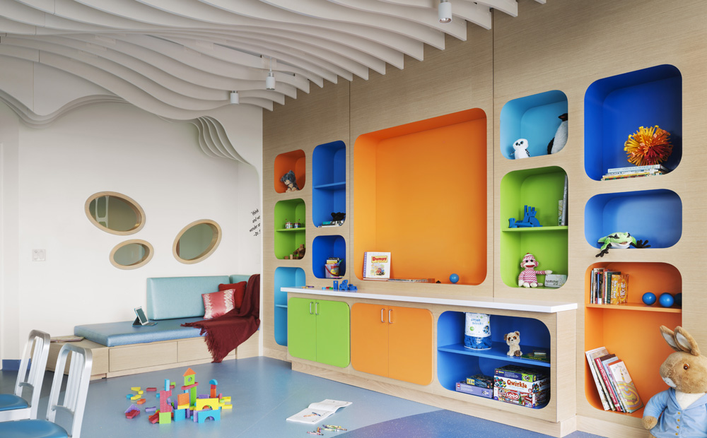 Children's play area with colorful bookshelves and toys