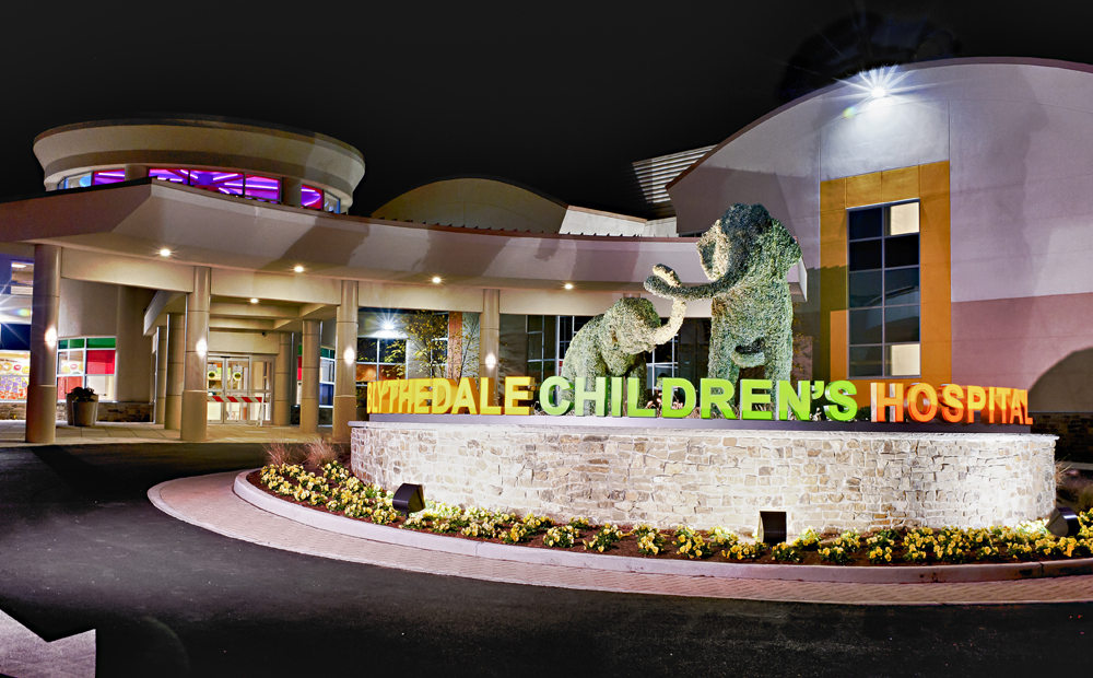 Blythedale Children's Hospital building front with sign and topiary elephants