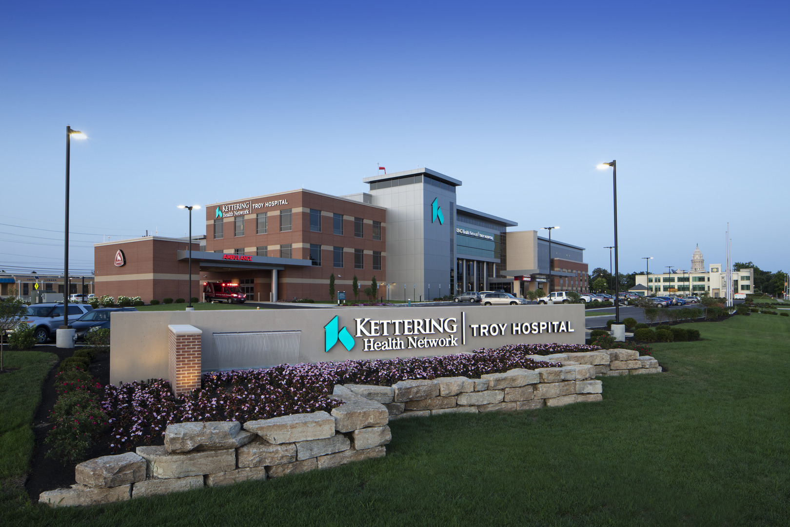 Kettering Health Network front view and sign with logo, surrounded by flowers