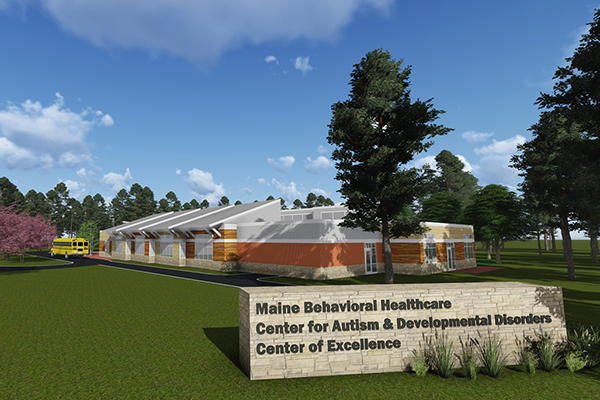 The Maine Behavioral Healthcare Center of Excellence in Autism and Developmental Disorders exterior and sign on sunny day